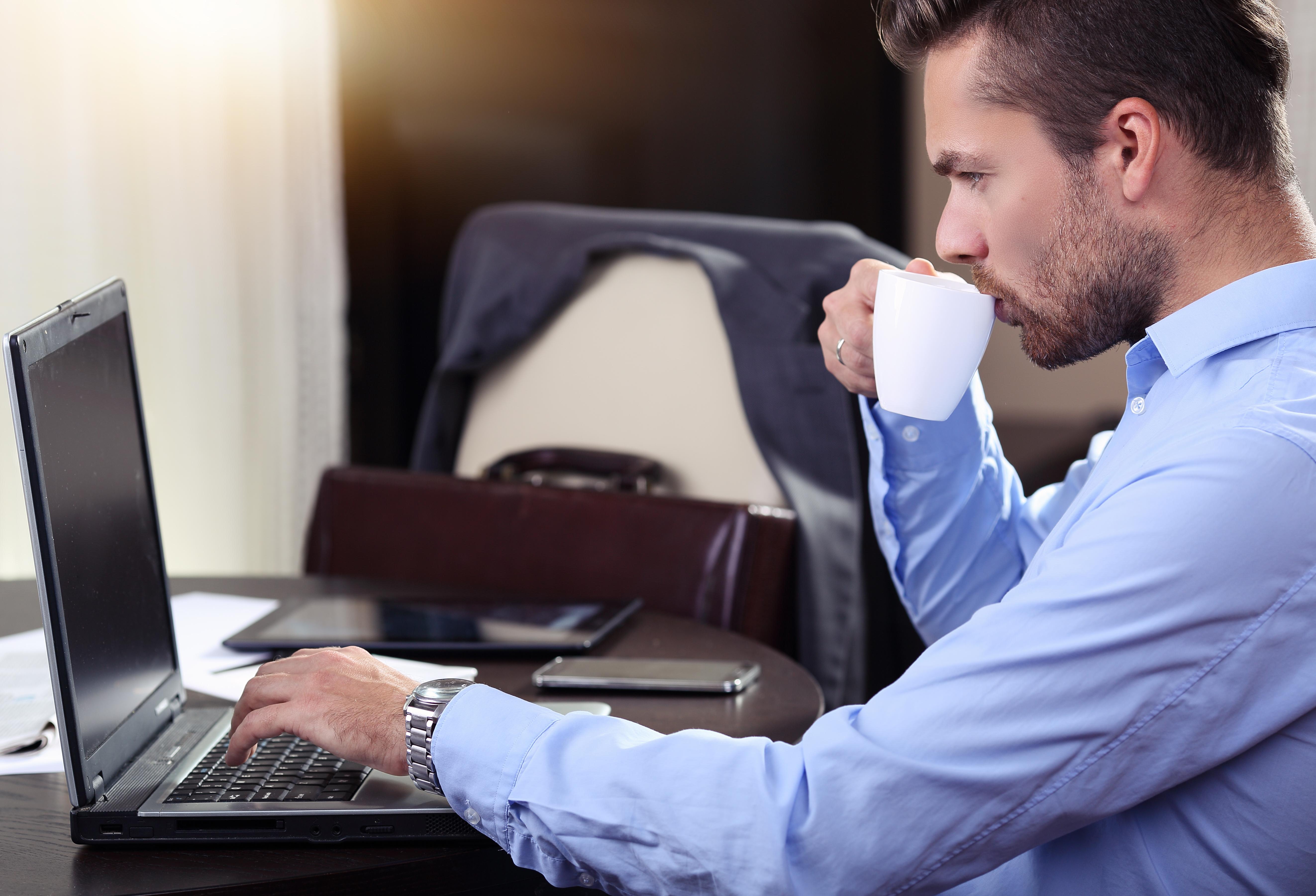 business-man-looking-laptop